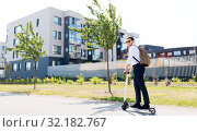 Купить «businessman with backpack riding electric scooter», фото № 32182767, снято 1 августа 2019 г. (c) Syda Productions / Фотобанк Лори