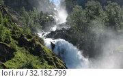 Купить «Latefoss or Latefossen waterfall. It consists of two separate streams flowing down. Municipality of Odda, Hordaland county, Norway. Europe», видеоролик № 32182799, снято 7 июня 2019 г. (c) Кекяляйнен Андрей / Фотобанк Лори
