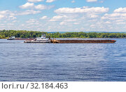 Купить «Cargo barge floats along the river», фото № 32184463, снято 2 июня 2019 г. (c) FotograFF / Фотобанк Лори