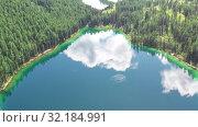 Купить «Aerial video view from drone on Altai natural landscape of Ulagan Plateau with Uchkol mountain lake. Altai, Siberia, Russia», видеоролик № 32184991, снято 24 августа 2019 г. (c) Serg Zastavkin / Фотобанк Лори