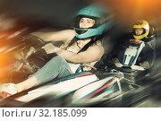 Купить «Female driving go-kart car indoor», фото № 32185099, снято 22 октября 2019 г. (c) Яков Филимонов / Фотобанк Лори