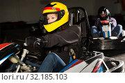 Купить «Female driving go-kart car indoor», фото № 32185103, снято 22 октября 2019 г. (c) Яков Филимонов / Фотобанк Лори