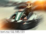 Купить «Female driving car for karting», фото № 32185131, снято 18 марта 2019 г. (c) Яков Филимонов / Фотобанк Лори