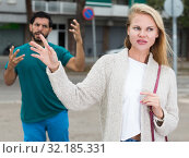 Купить «Portrait of female who is angering to adult stranger», фото № 32185331, снято 10 августа 2017 г. (c) Яков Филимонов / Фотобанк Лори
