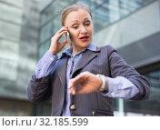 Купить «Portrait of busy female rushing to important meeting», фото № 32185599, снято 6 мая 2017 г. (c) Яков Филимонов / Фотобанк Лори