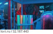 Купить «An alien with tentacles in the lower face looking around in the secret lab and inspects the equipment», видеоролик № 32187443, снято 19 октября 2019 г. (c) Константин Шишкин / Фотобанк Лори