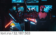 Купить «RUSSIA, KAZAN 10-09-2019: Secret Alien Research Lab - A Robot Controls the Work in thouse Walls - electric current generating machine on the foreground», видеоролик № 32187503, снято 20 октября 2019 г. (c) Константин Шишкин / Фотобанк Лори