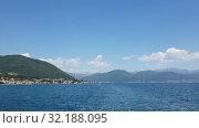 Купить «Fragment of the Bay of Kotor with houses on shore, Montenegro», видеоролик № 32188095, снято 12 июля 2019 г. (c) Володина Ольга / Фотобанк Лори