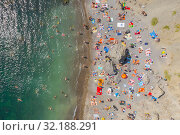 Aerial view of crowded colorful paradise beach on Black Sea, Crimea. Стоковое фото, фотограф Кирилл Трифонов / Фотобанк Лори