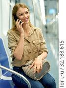 Купить «Nice girl speaks on the mobile phone in the subway train», фото № 32188615, снято 31 марта 2019 г. (c) Яков Филимонов / Фотобанк Лори