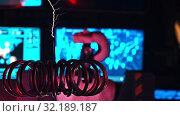 Купить «Secret Alien Research Lab - A Robot Controls the Work in these Walls - electric current generating machine on the foreground causing a little lightnings - technology exhibition», видеоролик № 32189187, снято 19 октября 2019 г. (c) Константин Шишкин / Фотобанк Лори