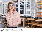 Купить «Thoughtful young female in store», фото № 32194135, снято 15 января 2018 г. (c) Яков Филимонов / Фотобанк Лори