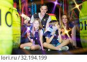 Купить «Kids and parents with laser guns in beams», фото № 32194199, снято 6 июня 2018 г. (c) Яков Филимонов / Фотобанк Лори