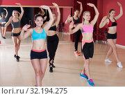 Купить «Group of happy young females practicing zumba», фото № 32194275, снято 31 мая 2017 г. (c) Яков Филимонов / Фотобанк Лори