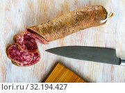 Купить «Appetizing salchichon sausage on wooden table», фото № 32194427, снято 20 сентября 2019 г. (c) Яков Филимонов / Фотобанк Лори