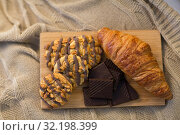 Купить «croissant, chocolate and cookies on wooden board», фото № 32198399, снято 15 октября 2016 г. (c) Syda Productions / Фотобанк Лори