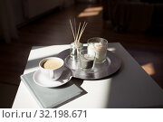 Купить «coffee, candles and aroma reed diffuser on table», фото № 32198671, снято 11 апреля 2019 г. (c) Syda Productions / Фотобанк Лори