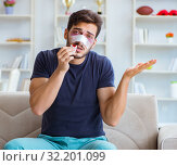 Купить «Young man recovering healing at home after plastic surgery nose», фото № 32201099, снято 26 июля 2017 г. (c) Elnur / Фотобанк Лори
