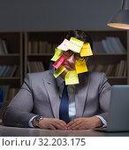Купить «Businessman staying late to sort out priorities», фото № 32203175, снято 25 января 2017 г. (c) Elnur / Фотобанк Лори
