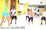 Купить «Smiling children dancing contemp in studio smiling and having fun», видеоролик № 32205499, снято 30 марта 2020 г. (c) Яков Филимонов / Фотобанк Лори