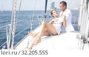 Купить «Young loving couple enjoying sea trip on pleasure sailboat along coast of Barcelona on sunny summer day», видеоролик № 32205555, снято 30 июля 2019 г. (c) Яков Филимонов / Фотобанк Лори