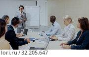Купить «Businessman making presentation on staff meeting at office», видеоролик № 32205647, снято 9 апреля 2020 г. (c) Яков Филимонов / Фотобанк Лори
