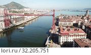 Купить «Aerial view of Bizkaia suspension Bridge in Portugalete, Spain», видеоролик № 32205751, снято 16 июля 2019 г. (c) Яков Филимонов / Фотобанк Лори