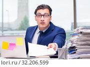 Купить «Workaholic businessman overworked with too much work in office», фото № 32206599, снято 11 октября 2016 г. (c) Elnur / Фотобанк Лори