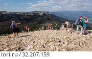 Ai-Petri, Crimea - July 5, 2019. Tourists walk on the highest point of Mount Ai-Petri. Редакционное видео, видеограф Володина Ольга / Фотобанк Лори
