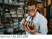 Купить «Strange engineer soldering chips, test in lab», фото № 32207299, снято 17 июня 2019 г. (c) Tryapitsyn Sergiy / Фотобанк Лори