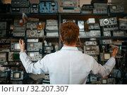 Купить «Scientist looking on shelf with devices in lab», фото № 32207307, снято 17 июня 2019 г. (c) Tryapitsyn Sergiy / Фотобанк Лори