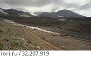 Купить «Japanese SUV Mitsubishi Delica driving on mountain road in direction of travel destinations for mountain adventure on active volcano. Time lapse», видеоролик № 32207919, снято 16 августа 2019 г. (c) А. А. Пирагис / Фотобанк Лори