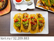 Купить «Mexican tacos with beef, guacamole and vegetables», фото № 32209883, снято 24 января 2020 г. (c) Яков Филимонов / Фотобанк Лори