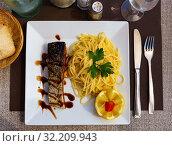 Купить «Baked salmon and pasta served with lemon and balsamic», фото № 32209943, снято 22 октября 2019 г. (c) Яков Филимонов / Фотобанк Лори