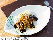 Купить «Crepes with cream cheese mousse, nut, chocolate», фото № 32210007, снято 15 декабря 2019 г. (c) Яков Филимонов / Фотобанк Лори
