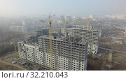 Купить «Aerial view of residential complex under construction in Moscow, Russia», видеоролик № 32210043, снято 17 октября 2019 г. (c) Данил Руденко / Фотобанк Лори