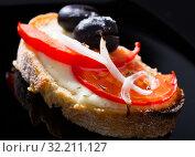 Купить «Sandwich with tomato and olives is tasty dish», фото № 32211127, снято 12 декабря 2019 г. (c) Яков Филимонов / Фотобанк Лори