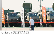 Купить «30 AUGUST 2019 MOSCOW, RUSSIA: an outdoors exposition - trucks are behind the fence», видеоролик № 32217135, снято 21 февраля 2020 г. (c) Константин Шишкин / Фотобанк Лори
