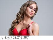 Купить «Model with wavy hair advertises erotic lingerie», фото № 32218387, снято 22 марта 2016 г. (c) Гурьянов Андрей / Фотобанк Лори