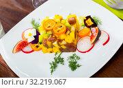 Купить «Delicious tartare of tuna with mango, avocado and fig, served with flower», фото № 32219067, снято 14 октября 2019 г. (c) Яков Филимонов / Фотобанк Лори