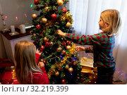 Купить «Brother and sister at home at Christmas time», фото № 32219399, снято 6 сентября 2019 г. (c) Wavebreak Media / Фотобанк Лори