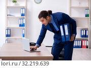 Купить «Young male accountant working in the office», фото № 32219639, снято 20 июля 2019 г. (c) Elnur / Фотобанк Лори