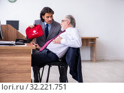 Male employee suffering from heart attack in the office. Стоковое фото, фотограф Elnur / Фотобанк Лори