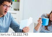 Купить «Young couple looking at family finance papers», фото № 32222743, снято 27 ноября 2017 г. (c) Elnur / Фотобанк Лори