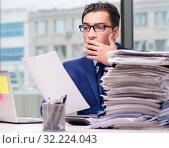 Купить «Workaholic businessman overworked with too much work in office», фото № 32224043, снято 11 октября 2016 г. (c) Elnur / Фотобанк Лори
