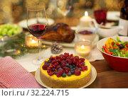 Купить «cake and other food on christmas table at home», фото № 32224715, снято 17 декабря 2017 г. (c) Syda Productions / Фотобанк Лори