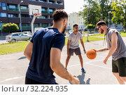 Купить «group of male friends playing street basketball», фото № 32224935, снято 21 июля 2019 г. (c) Syda Productions / Фотобанк Лори