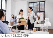 Купить «executive seeing off fired female office worker», фото № 32225099, снято 23 марта 2019 г. (c) Syda Productions / Фотобанк Лори