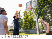 group of male friends playing street basketball. Стоковое фото, фотограф Syda Productions / Фотобанк Лори