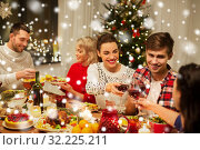 Купить «happy friends drinking red wine at christmas party», фото № 32225211, снято 17 декабря 2017 г. (c) Syda Productions / Фотобанк Лори